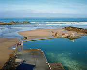 Summerleaze Sea Pool was built in the 1930s when seawater swimming pools were all the rage, Bude, Cornwall, UK.  Nestled at the foot of the cliffs, Summerleaze Sea Pool is part man made and part natural rock pool and it cleaned daily by the tide. Until the 1950s and the rise of the heated indoor swimming pool, children learnt to swim outdoors. For those close to the sea, many man-made tidal swimming pools were constructed around Britain's coastline. Heated by the sun, these tidal pools were often built to keep bathers safe from high and rough seas, which explains why so many of them are clustered in Scotland and around the surfing beaches of Cornwall. Whether they are simple swimming holes made by shoring up natural rock pools or grand lido-like pools complete with lifeguards and tea huts, they are all refreshed by good high tides.