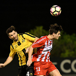 BRISBANE, AUSTRALIA - APRIL 13: Matt Byrne of Moreton Bay competes for a headed ball with Michael Morrow of Olympic FC during the NPL Queensland Senior Men's Round 4 match between Olympic FC and Moreton Bay Jets at Goodwin Park on April 13, 2017 in Brisbane, Australia. (Photo by Patrick Kearney/Olympic FC)