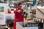 An employee works at the New Mechanical Machining Area of the Ferrari auto plant in Maranello, Italy, on Monday, July 18, 2011. Photographer: Victor Sokolowicz/Bloomberg
