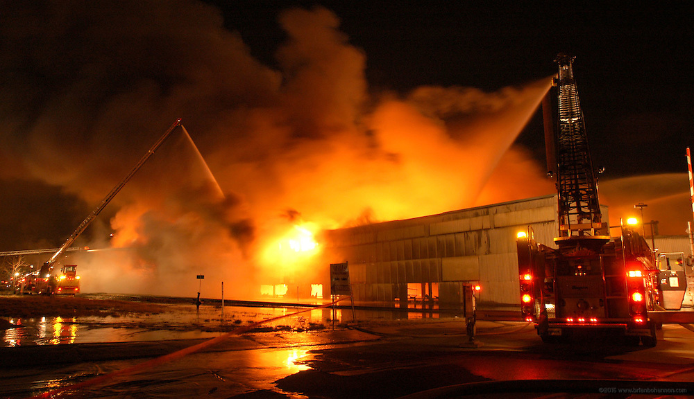 Louisville Metro Fire Department battles a six-alarm fire in a three-story warehouse Friday, March 17, 2006, in Louisville, Ky. The cause of the fire was unknown and no injuries were reported. (AP Photo/Brian Bohannon)