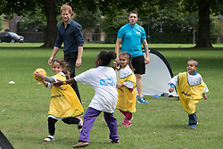 Prince Harry during a visit to a summer holiday activity session run by Newham Council's leisure trust at Central Park, East Ham, London.