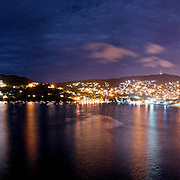 A night time panorama of the Playa Principal, bay, and city lights of Zihuatenejo looking west.