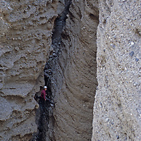 A mountaineer rappels below Shipton's Arch in the Kara Tagh Mountains near Kashgar, Xinjiang, China.