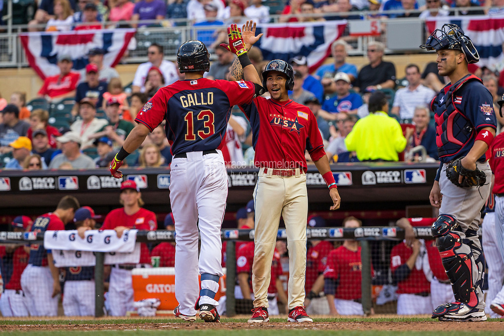 MINNEAPOLIS, MN- JULY 13: Joey Gallo #13 of the U.S. Team celebrates his home run with J.P. Crawford #21 during the SiriusXM All-Star Futures Game at Target Field on July 13, 2014 in Minneapolis, Minnesota. (Photo by Brace Hemmelgarn) *** Local Caption *** Joey Gallo;J.P. Crawford