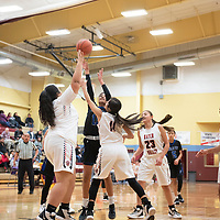 Navajo Pine's Kamara Goodluck (15) drives to the basket for the shot against Hatch Valley Friday evening at the 2020 Rehoboth Christian High School girls basketball tournament in Rehoboth.