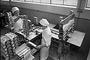 17/01/1963<br /> 01/17/1963<br /> 17 January 1963<br /> Interiors of Liam Devlin and Sons Ltd. Dublin Sweet Factory at Cork Street, Dublin. Image shows machinery for packaging candy sweet-cigarettes.