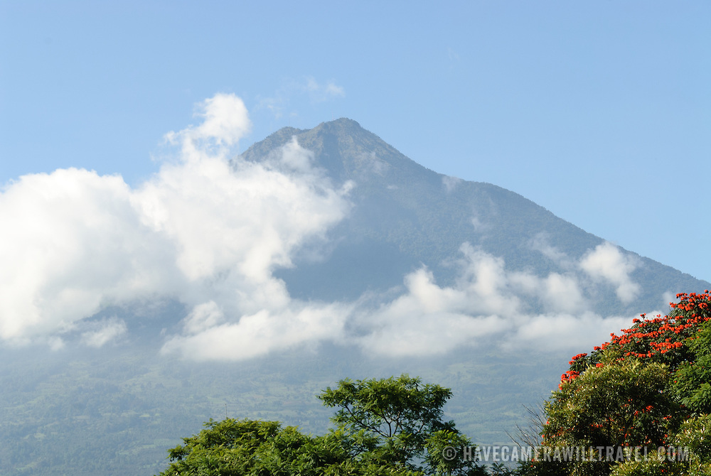 View of Volcan de Agua partially covered in clouds as seen from Antigua Guatemala. It's one of three volcanoes near Antigua.
