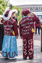 © Licensed to London News Pictures. 30/05/2015. London, UK. A young boy and girl, dressed as an Aston Villa pearly king and queen, are amongst the fans gathered at Wembley Stadium for the FA Cup Final 2015, between Arsenal and Aston Villa. Photo credit : Stephen Chung/LNP