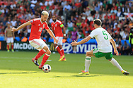 Aaron Ramsey of Wales (l) looks to go past Jonny Evans of Northern Ireland. UEFA Euro 2016, last 16 , Wales v Northern Ireland at the Parc des Princes in Paris, France on Saturday 25th June 2016, pic by  Andrew Orchard, Andrew Orchard sports photography.