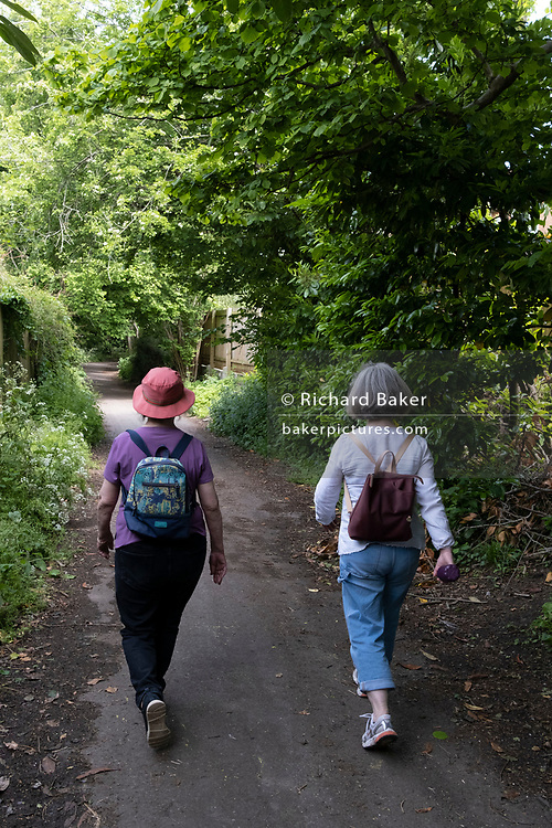 A mother and daughter walk along a country lane, on 30th May 2021, in Nailsea, North Somerset, England.