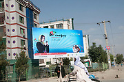 Afghanistan. Kabul. Advert for mobile phone, using a photo of a woman.