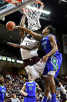 Texas A&M's Jalen Jones (12) draws a foul by Florida Gulf Coast University's Koshua Ko (3) while driving the lane during a NCAA college basketball game in College Station, Texas, Wednesday, Dec. 2, 2015.  (AP Photo/Sam Craft)