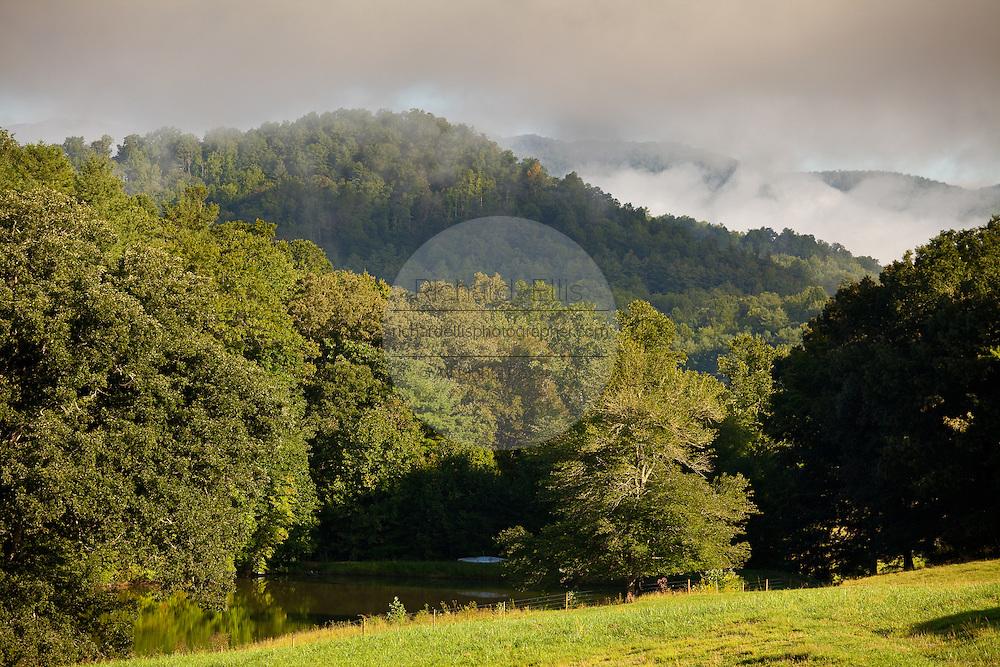 Morning mist rises in the Blue Ridge mountains of western North Carolina.