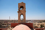A cross dangles from the damaged bell tower at the Church of the Immaculate Conception, a Syriac Catholic church in the Iraqi town of Qaraqosh that was occupied by ISIS from 2014 to 2016.  Also known as Hamdaniya, the predominately Christian town of Qaraqosh is located about 30 kilometres from Mosul. (May 20, 2017)