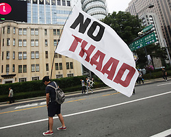 June 24, 2017 - Seoul, South Korea - A demonstrator attend a protest against the deployment of THAAD in Seoul, South Korea. Thousands of South Korean protestors against the deployment of the U.S. Terminal High Altitude Area Defense (THAAD) in their homeland took to the streets in central Seoul to demand the reversal of the installation decision. (Credit Image: © Yao Qilin/Xinhua via ZUMA Wire)