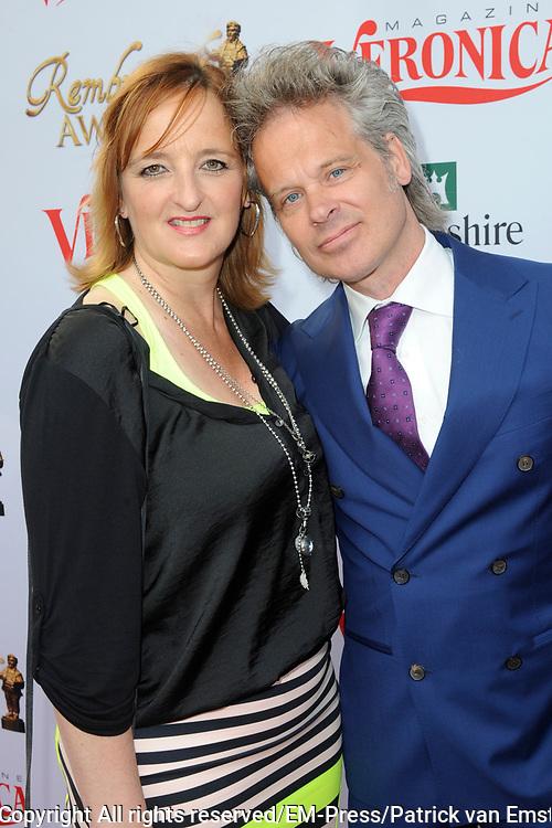 Rembrandt Awards - 2014 in het American Hotel, Amsterdam.<br /> <br /> Op de foto: Norman Bonink met partner