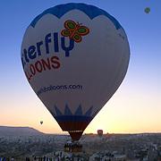 Hot air balloon flying close over the people, Cappadocia, Turkey