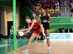 England's Helen Housby (GA) holds off New Zealand's Temalisi Fakahokotau (GK) in the netball at the Gold Coast Convention and Exhibition Centre during day seven of the 2018 Commonwealth Games in the Gold Coast, Australia.