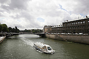 France, Paris Tourist river bus travelling along the Seine