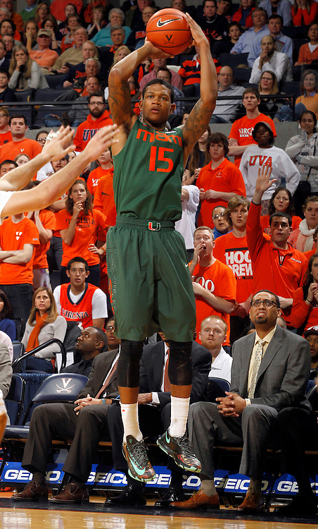 Miami guard Rion Brown (15) shoots a three point play during an NCAA basketball game Saturday Feb, 24, 2014 in Charlottesville, VA. Virginia defeated Miami 65-40.