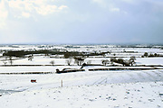 View of the snowy winter landscape from Osgoodby Bank towards the Vale of Mowbray in North Yorkshire, UK on 28 February 2018