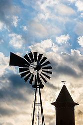 Silhouette of windmill and tower of Grapevine Convention and Visitors Bureau, Grapevine, Texas USA