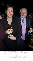 MR & MRS JOHNNY GOLD he is the nightclub owner, at a party in London on 17th January 2001.OKM 24