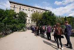 Clubbers queuing outside Berghain nightclub on a Sunday afternoon in Berlin Germany