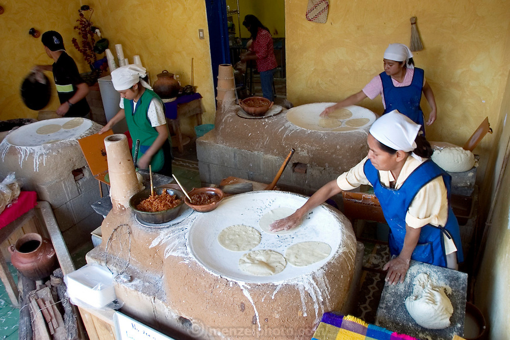 The Itanoni Tortillería in Oaxaca, Mexico, sells handmade tortillas cooked on top of traditional clay ovens. It contracts with local growers to produce increasingly rare native varieties of corn. Oaxaca is the center of diversity for corn, the world headquarters, so to speak, of its gene pool. (Supporting image from the project Hungry Planet: What the World Eats.)