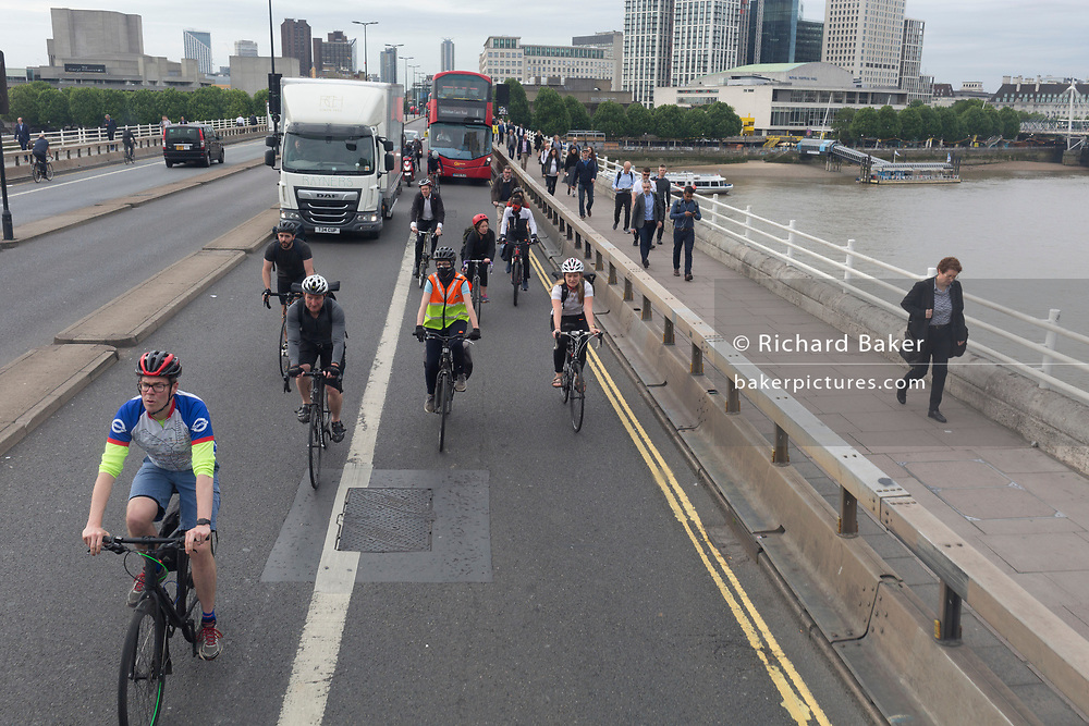 Cyclists and pedestrians make their way northwards during the morning rush-hour, on 4th June 2019, in London, England.