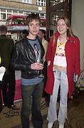 Bee Carr and Eva Rice. Shanghai Tang opening. Sloane St. 11 April 2001. © Copyright Photograph by Dafydd Jones 66 Stockwell Park Rd. London SW9 0DA Tel 020 7733 0108 www.dafjones.com