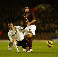 Photo: Chris Ratcliffe.<br />Arsenal v Sparta Prague. UEFA Champions League.<br />02/11/2005.<br />Jose Antonio Reyes (R) is tackled by Michal Kadlec