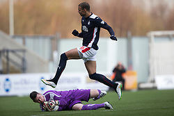Falkirk's Taylor Morgan over Brechin City's keeper Graeme Smith. <br /> Falkirk 2 v 1 Brechin City, Scottish Cup fifth round game played today at The Falkirk Stadium.
