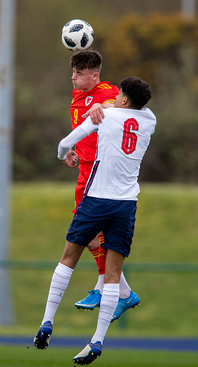 CARDIFF, WALES - Monday, March 29, 2021: Wales' Ryan Viggars (L) challenges for a header with England's Jarell Quansah during an Under-18 international friendly match between Wales and England at Leckwith Stadium. England won 2-0. (Pic by David Rawcliffe/Propaganda)