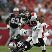 New England wide receiver Chad Ochocinco (85) gets tackled by Tampa Bay linebacker Quincy Black (59) during an NFL football game between the New England Patriots and the Tampa Bay Buccaneers at Raymond James Stadium on Thursday, August 18, 2011 in Tampa, Florida.   (Photo/Alex Menendez)
