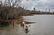 Diane Wilson kayaking away from the Point Comfort Texas plant carrying a bag full of nurdles she collected from one of Formosa's outfall areas on January 15, 2020.  Wilson  was a lead plantif in a  case against the Formosa Plastics Corp. USA  that resulted in a $50-million-dollar settlement and a range of conditions in an agreement known as a consent decree. Key among the conditions was the company's promise to halt releasing the nurdles it manufactures into local waterways leading to the Texas Gulf Coast