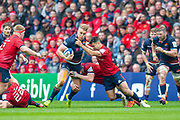 Duhan van der Merwe (#11) of Edinburgh Rugby charges at the Munster defence during the Heineken Champions Cup quarter-final match between Edinburgh Rugby and Munster Rugby at BT Murrayfield Stadium, Edinburgh, Scotland on 30 March 2019.
