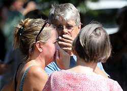 August 2, 2017 - Minneapolis, MN, USA - Former Minnehaha Academy employees Elizabeth Van Pilsum, left, who worked at the school for 20 years until 2015, and Rick Olson, middle, a former Spanish teacher whose two children graduated from the school react following an explosion and building collapse at Minnehaha Academy on Wednesday, Aug. 2, 2017, in Minneapolis, Minn. ''My friends are in there,'' Van Pilsum said. (Credit Image: © David Joles/TNS via ZUMA Wire)