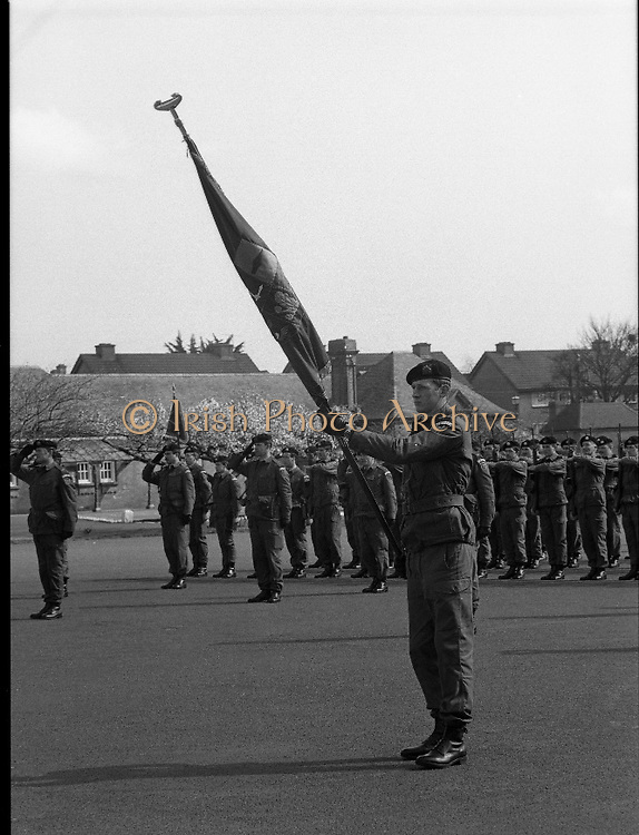 1983-04-12.12th April 1983.12-04-1983.04-12-83..Photographed at McKee Barracks, Cork..Military Salute..Lieutenant Martin Murphy of Cork bearing the new battalion flag close to his saluting colleagues...