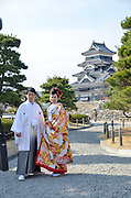 Japan, Tokyo, Traditional Shinto Wedding a couple in traditional dress