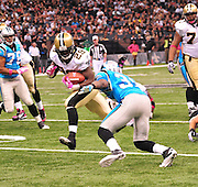 "New Orleans Saints RB Chris Ivory breaks a tacklem then takes a hard hit and fumbles the ball during the game against the Carolina Panthers Sunday Oct. 3,2010. The NFL has gone ""Pink"" for October in honor of Breast Cancer Awareness. The Saints went on to win 16-14. John Carney kicked three field goals to help the Saints win. PHOTO©SuziAltman.com"