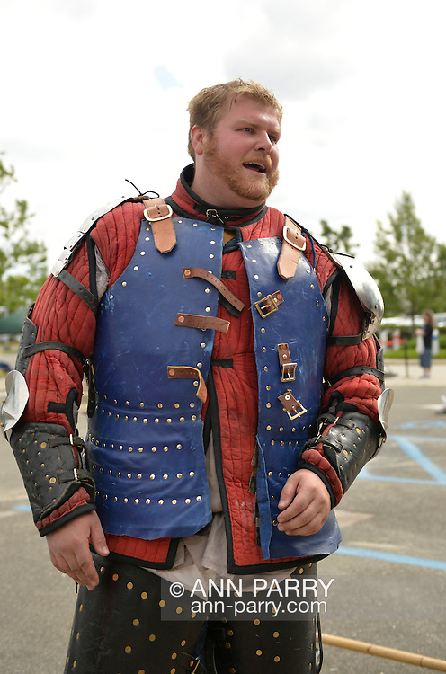 Garden City, New York, U.S. - June 14, 2014 - ANDREW DIONNE, of Bowie MD, is a USA Knights member wearing warrior combat sport armor at Eternal Con, the Long Island Comic Con Pop Culture Expo, held at the Cradle of Aviation Museum. Armored Combat League members compete in international medieval combat competitions.