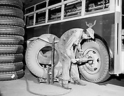 Y-480122-16. Changing tires on bus, February 3, 1948 at Piedmont Yard. Portland Traction Co.