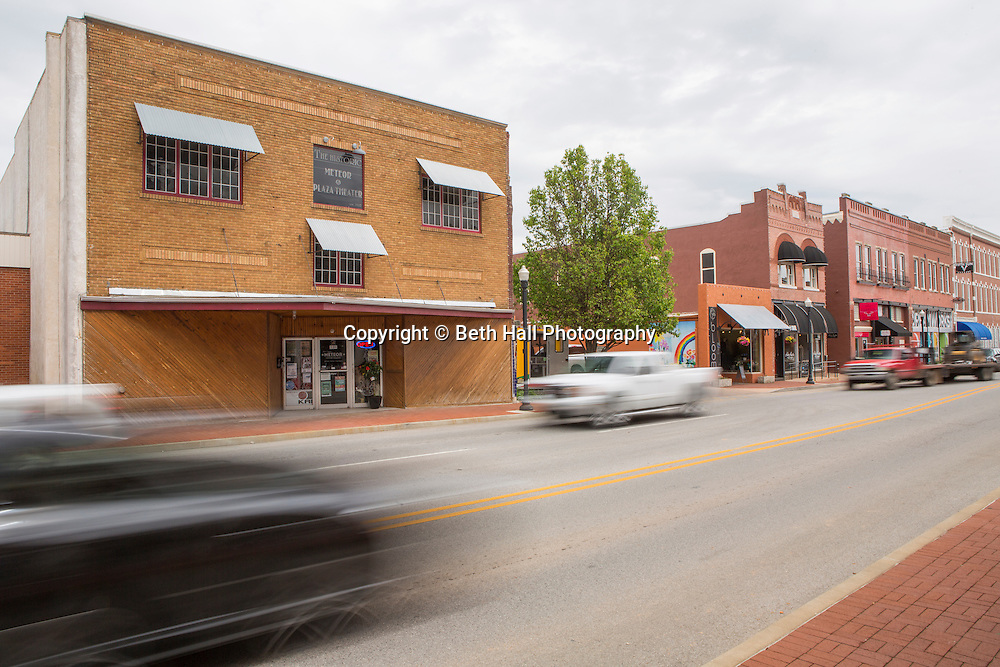 Cars drive past Meteor Guitar Gallery on Thursday, April 23, 2015, in Bentonville, Ark. The gallery used to be the town's movie theatre, and has recently reopened as a vintage and custom-made guitar shop and art space.<br /> <br /> Photo by Beth Hall