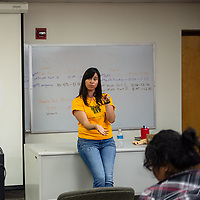 Elsa Lopez of Somos Gallup opens up the Wage Theft Forum at UNM Gallup North campus Tuesday evening in Gallup.