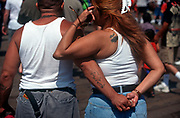 From behind, a 1990s Hispanic couple hold hands on Venice beach, on 18th May 1996, in Los Angeles, California, USA. (Photo by Richard Baker / In Pictures via Getty Images)