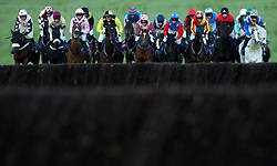 Runners and riders before clearing the first in the Ryman Stationery Cheltenham Business Club Amateur RidersÕ Handicap Chase during day one of The Showcase at Cheltenham Racecourse.