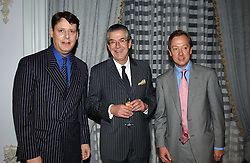 Left to right, JEREMY WAYNE Restaurant Editor of Tatler, MICHEL JANNEAU MD of Champagne Louis Roederer and GEORDIE GREIG Editor of Tatler at the Tatler Restaurant Awards in association with Champagne Louis Roederer held at the Four Seasons Hotel, Hamilton Place, London W1 on 10th January 2005.<br />