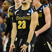 Wichita State Shockers guard Fred VanVleet (23) reacted after hitting a 3-point basket to take the lead into halftime against the Kansas Jayhawks during the third round of the NCAA men's basketball tournament on March 22, 2015, at CenturyLink Center in Omaha, Neb.
