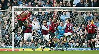 Photo: Scott Heavey.<br /> Aston Villa v Manchester City. FA Barclaycard Premiership. 04/04/2004.<br /> Sylvain Distin heads in the equaliser fro Man City